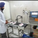 Another photo of Working of automatic Batch coding machine